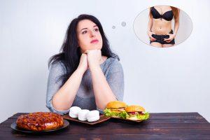 Frau träumt vom schlank sein